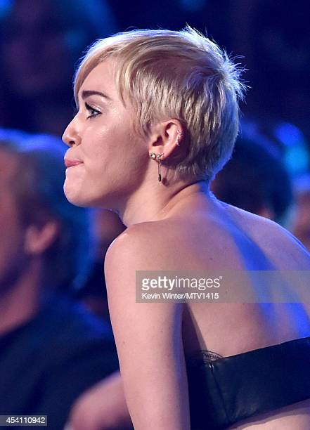 Singer Miley Cyrus wins Video of the Year for 'Wrecking Ball' onstage during the 2014 MTV Video Music Awards at The Forum on August 24 2014 in...