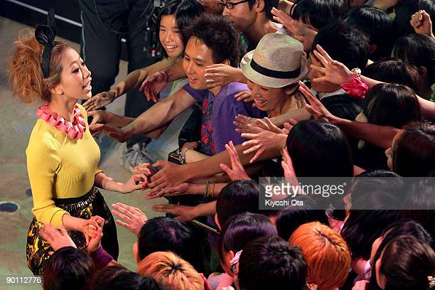 Singer Miliyah Kato greets fans as she attends an award ceremony for the Best 'Student Voice' Artist award during the MTV Student Voice Awards 2009...