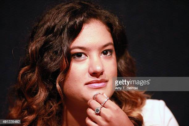 Singer Mina Tobias daughter of actress Madchen Amick sits with her mom during an authograph session at the sixth annual Twin Peaks UK Festival at...