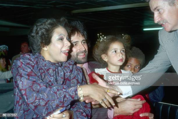 Singer Minnie Riperton her husband Richard Rudolph and children Maya Rudolph and Marc Rudolph greet a fan at the Hollywood Christmas Parade in circa...