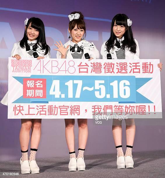 Singer Mion Mukaichi, Minami Takahashi and Saya Kawamoto of Japanese girl group AKB48 perform on the stage during a Japan tourism exhibition on April...