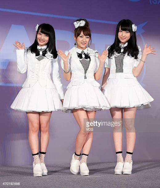 Singer Mion Mukaichi Minami Takahashi and Saya Kawamoto of Japanese girl group AKB48 perform on the stage during a Japan tourism exhibition on April...