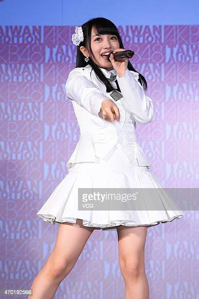 Singer Mion Mukaichi of Japanese girl group AKB48 performs on the stage during a Japan tourism exhibition on April 17 2015 in Taipei Taiwan of China