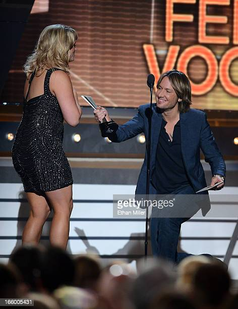 Singer Miranda Lambert accepts the Female Vocalist of the Year award from recording artist Keith Urban onstage during the 48th Annual Academy of...