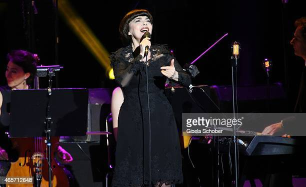 Singer Mireille Mathieu performs live on stage at Deutsches Theatre on March 9 2015 in Munich Germany