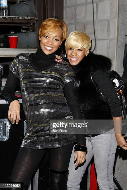 Singer Monica and Keyshia Cole pose backstage at the Double Up Tour with RKelly on November 15 2007 in Atlanta Georgia