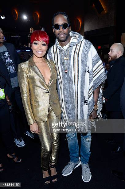 Singer Monica and rapper 2 Chainz onstage at The Players' Awards presented by BET at the Rio Hotel Casino on July 19 2015 in Las Vegas Nevada