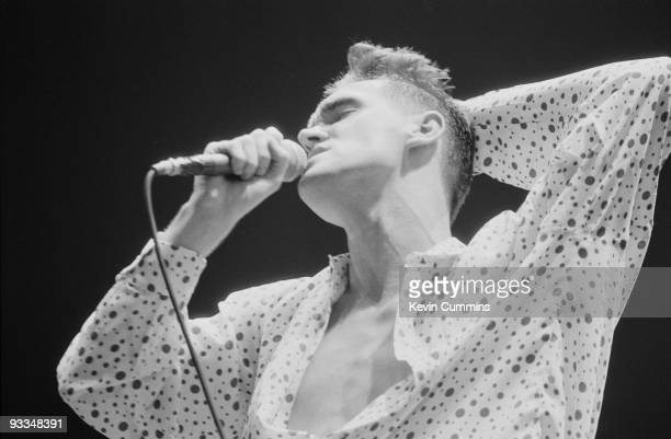 Singer Morrissey performing with English pop group The Smiths at the GMEX centre Manchester at the Festival Of The 10th Summer during their 'The...