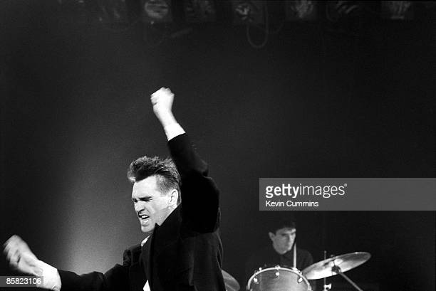 Singer Morrissey performing with English pop group The Smiths for the Oxford Road Show TV programme Manchester 22nd February 1985 Drummer Mike Joyce...