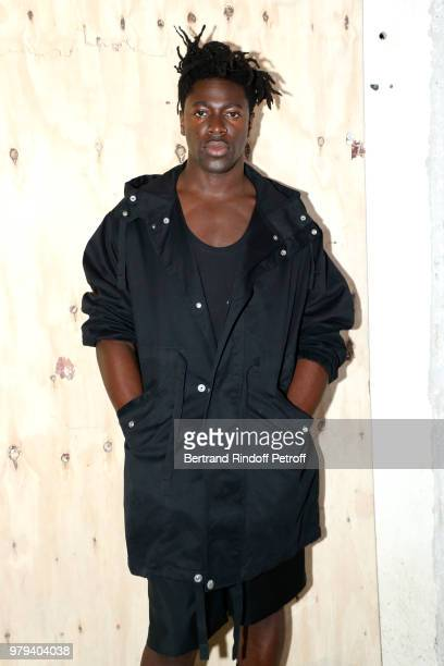 Singer Moses Sumney attends the Acne Studio Menswear Spring/Summer 2019 show as part of Paris Fashion Week on June 20 2018 in Paris France