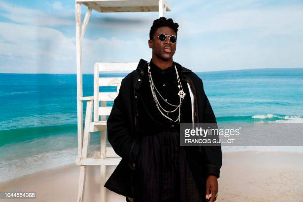 US singer Moses Sumney poses during a photocall prior to the Chanel SpringSummer 2019 ReadytoWear collection fashion show at the Grand Palais in...