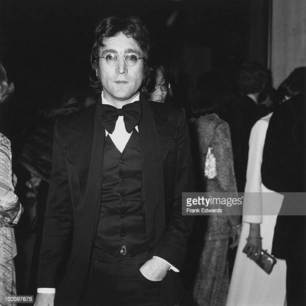 Singer musician and songwriter John Lennon a former member of British pop group The Beatles attends the American Film Institute's tribute to James...