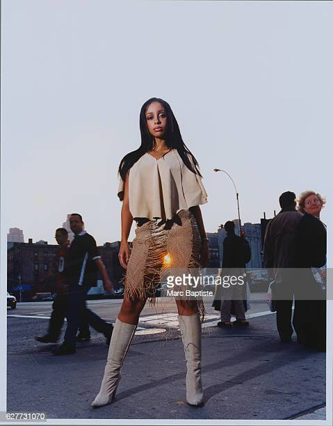Singer Mya is photographed for Vibe Magazine in February 2000