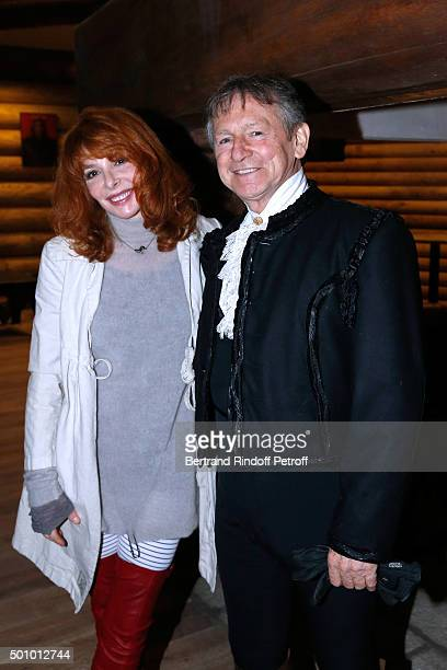 Singer Mylene Farmer and Mario Luraschi attend the Mario Luraschi's Espace Cavalcade Opening Night at Ferme De La Chapelle on December 11 2015 in...