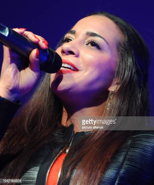 Singer Nadja Benaissa performes during the celebration of the thirty year anniversary of the German AIDS Service Organization in Berlin Germany...