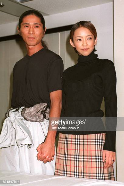 Singer Namie Amuro and dancer SAM of TRF attend a press conference on their marriage on October 16 1997 in Tokyo Japan