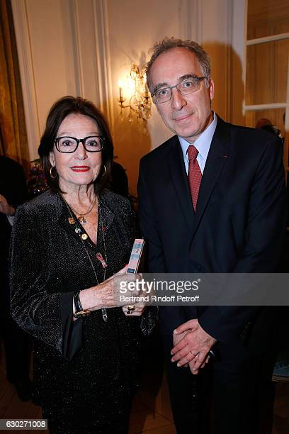 """Singer Nana Mouskouri and Francois Weil attend Nana Mouskouri gives the Greek Prize """"Nikos Gatsos 2016"""" to Charles Aznavour at Embassy of Greece on..."""