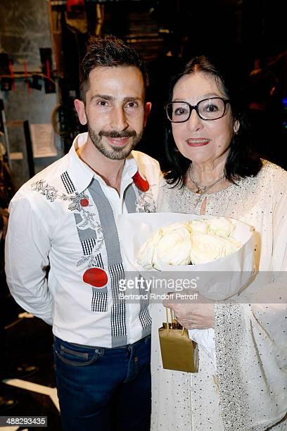 Singer Nana Mouskouri and Greek singer Polydoros Vogiatzis pose after Nana Mouskouri perfomed on her Happy Birthday Tour Held at 'Theatre du...