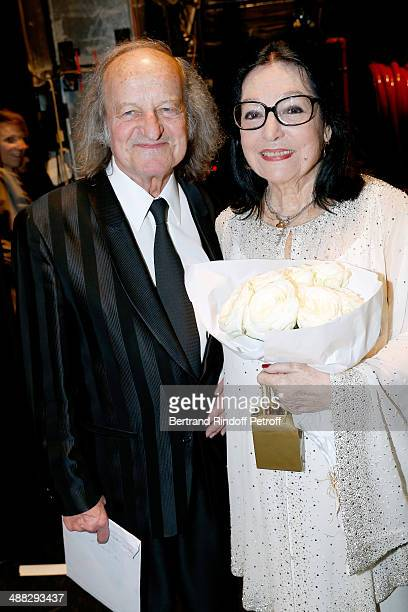 Singer Nana Mouskouri and her husband Andre Chapelle pose after Nana Mouskouri perfomed on her Happy Birthday Tour Held at 'Theatre du Chatelet' on...