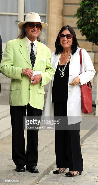 Singer Nana Mouskouri and Husband in the courtyard of the Elysee Palace before attending a ceremony at the president's official residence for...