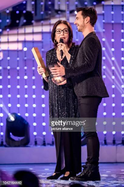 Singer Nana Mouskouri and the moderator Florian Silbereisen during the TV Show 'Hit Champions Great party of the best' at the Velodrom in Berlin...