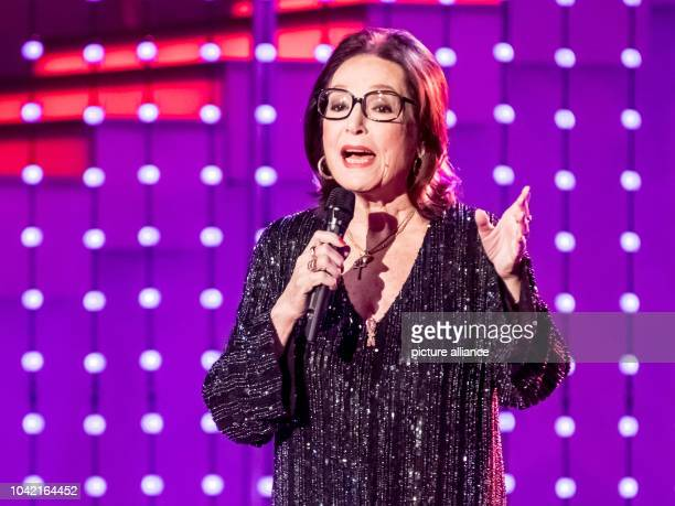 """Singer Nana Mouskouri during the TV Show """"Hit Champions - Great party of the best"""" at the Velodrom in Berlin, Germany, 7 January 2017. Photo: Andreas..."""
