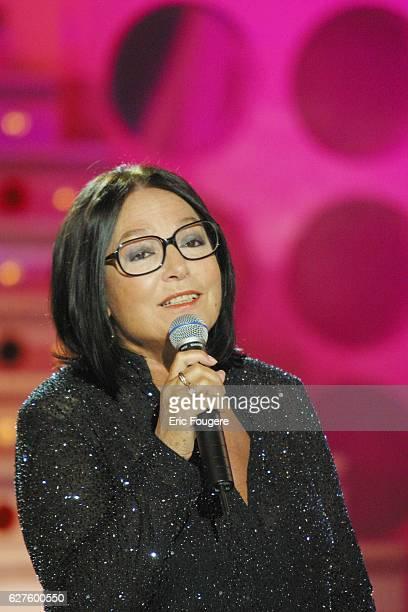 Singer Nana Mouskouri guest on host Michel Drucker's Sunday television show Vivement Dimanche