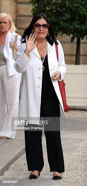 Singer Nana Mouskouri in the courtyard of the Elysee Palace before attending a ceremony at the president's official residence for honorees of...