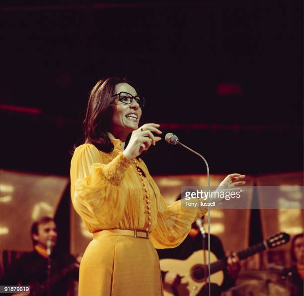 Singer Nana Mouskouri performs on a BBC television show in 1974