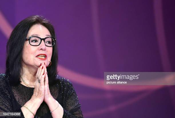 Singer Nana Mouskouri stands on stage during the Echo Music Awards ceremony in Berlin Germany 26 March 2015 Mouskouri was awarded in the categroy...
