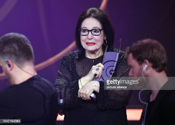 Singer Nana Mouskouri stands on stage with her award during the Echo Music Awards ceremony in Berlin Germany 26 March 2015 Mouskouri was awarded in...