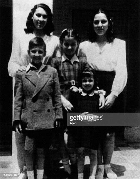 Singer Nana Mouskouri, young with her sister Eugenie aka Jenny and children of the owners of their house in Athens, 1946