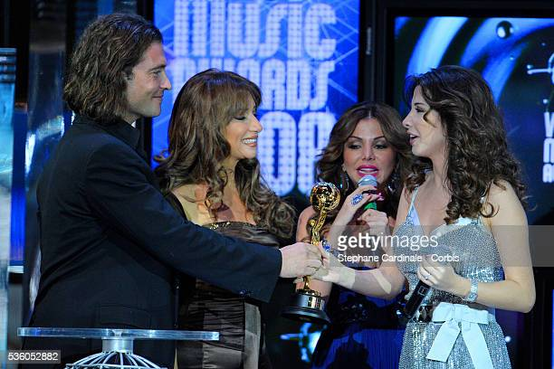 Singer Nancy Ajram on stage with her 'Best Middle East Artist' Award during the ceremony of the 2008 World Music Awards in Monte Carlo