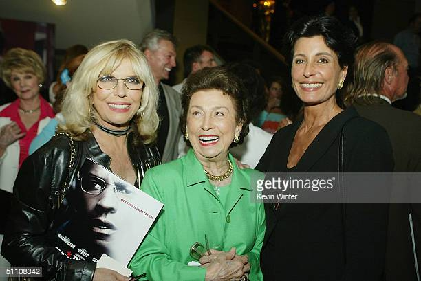 Singer Nancy Sinatra Nancy Sinatra Sr and producer Tina Sinatra pose at the afterparty for the premiere of Paramounts' The Manchurian Candidate at...