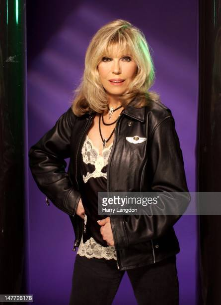 Singer Nancy Sinatra poses for a portrait session, in 2004 in Los Angeles, California.