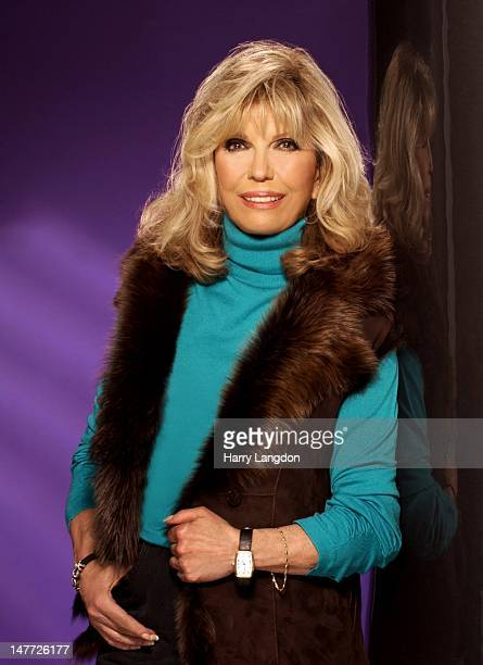 Singer Nancy Sinatra poses for a portrait session in 2004 in Los Angeles California
