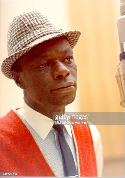 Singer Nat King Cole records during a session in the Capitol Recording Studios in circa 1964 in Los Angeles California