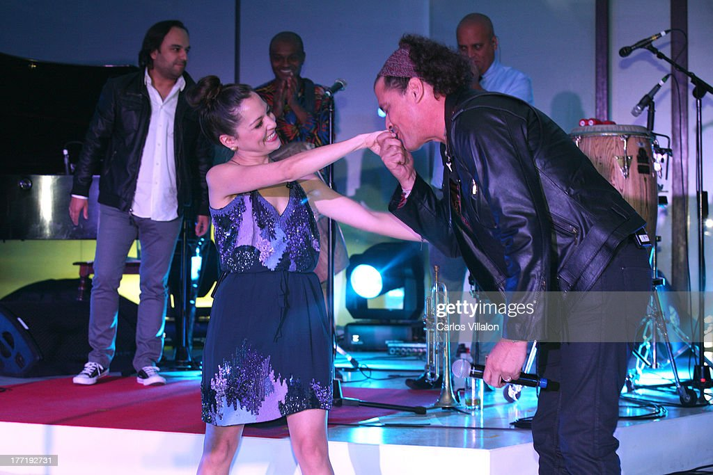 Singer Natalia Lafourcade and singer Carlos Vives perform at the Latin GRAMMY Acoustic Session at Country Club de Bogota on August 21, 2013 in Bogota, Colombia.