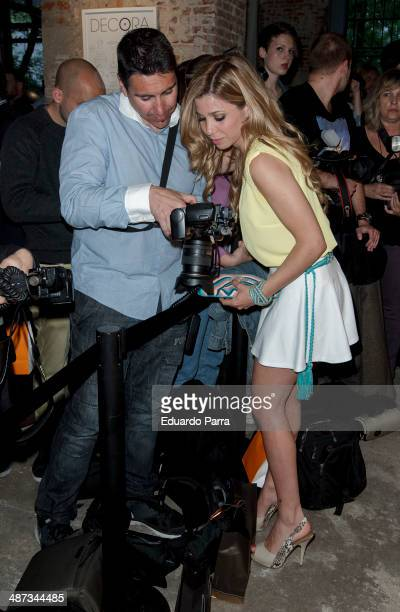 Singer Natalia Rodriguez she checks the pictures the photographer Miguel Moya has taken at the 'Decoration party by El Corte Ingles' photocall at El...