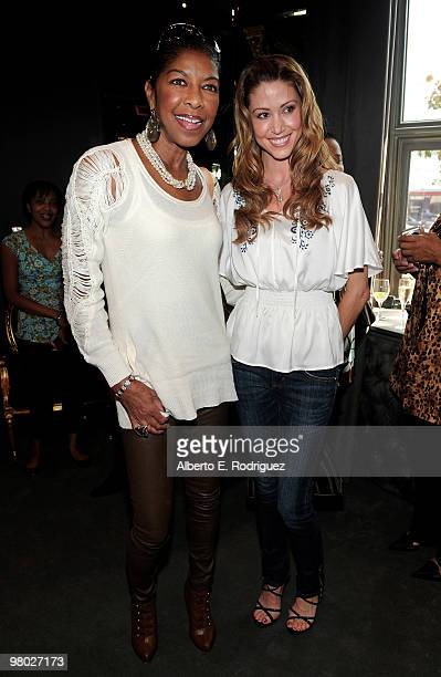 Singer Natalie Cole and actress Shannon Elizabeth pose at 'A Parisian Afternoon' hosted by The House of Lloyd Klein Couture on March 24, 2010 in Los...