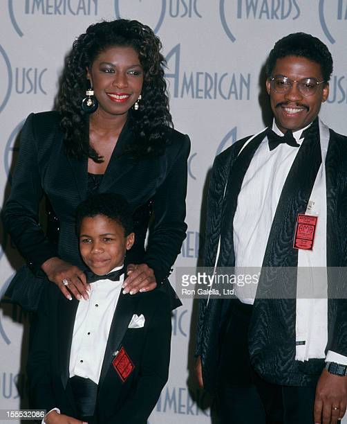 Singer Natalie Cole son Robert Yancy and Herbie Hancock attending 15th Annual American Music Awards on January 25 1988 at Shrine Auditorium in Los...
