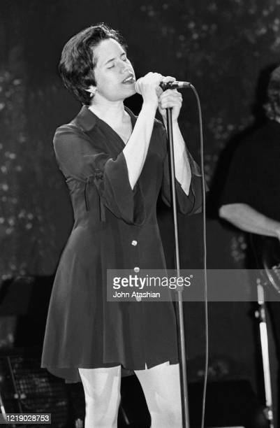 Singer Natalie Merchant is shown performing on stage during a live concert appearance with the 10000 Maniacs on June 30 1989