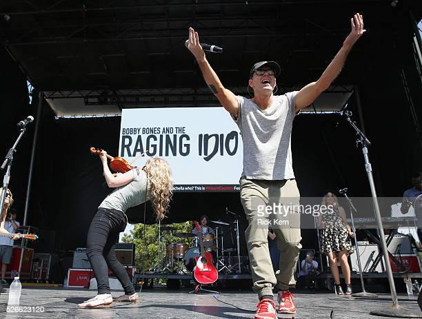 Singer Natalie Stovall and radio personality Bobby Bones of Bobby Bones and The Raging Idiots perform live during the 2016 Daytime Village at the...