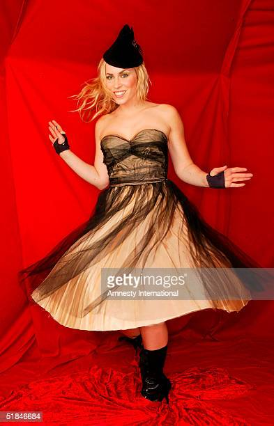 Singer Natasha Bedingfield poses in a Victorianthemed booth at the 'Amnesty International VIP Burlesque Party' at Canvas on November 25 2004 in...