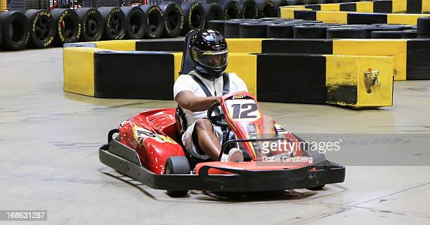 Singer Nathan Morris of the group Boyz II Men races a gokart at a Boyz II Men House charity event to benefit Children's Speedway Charities at Pole...