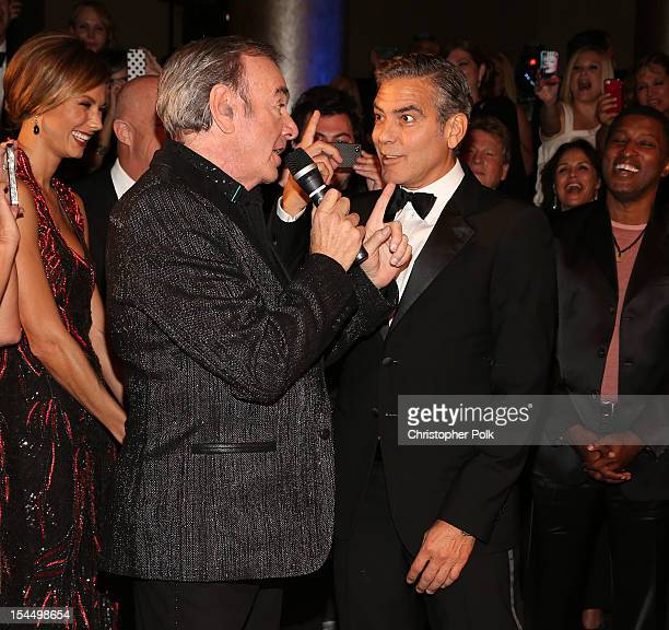 Singer Neil Diamond and actor George Clooney perform during the 26th Anniversary Carousel Of Hope Ball presented by MercedesBenz at The Beverly...
