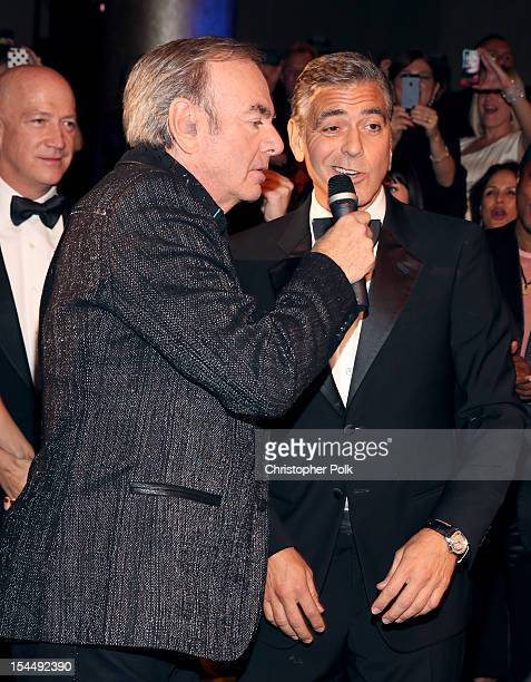 Singer Neil Diamond and actor/honoree George Clooney perform during the 26th Anniversary Carousel Of Hope Ball presented by MercedesBenz at The...