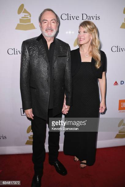 Singer Neil Diamond and Katie McNeil attend PreGRAMMY Gala and Salute to Industry Icons Honoring Debra Lee at The Beverly Hilton on February 11 2017...
