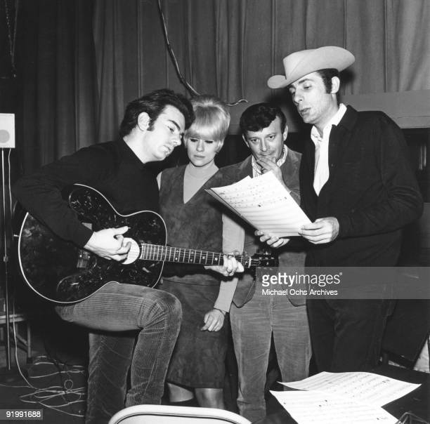 Singer Neil Diamond and songwriters and producers Ellie Greenwich Bert Berns and Jeff Barry work up a tune in circa 1966