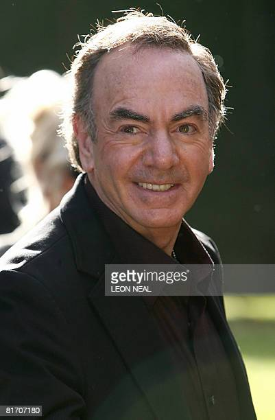 US singer Neil Diamond arrives at Nelson Mandela's birthday dinner in Hyde park in London on June 25 2008 With a concert to celebrate his 90th...